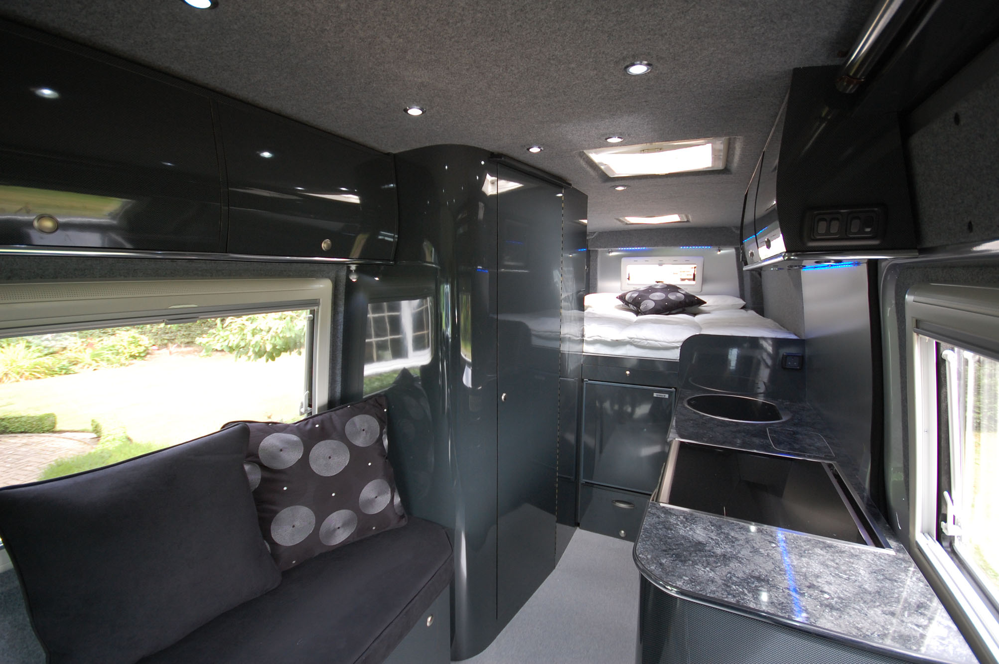 Interior floors walls and surfaces fitted in vehicle adaptation into holiday campervan