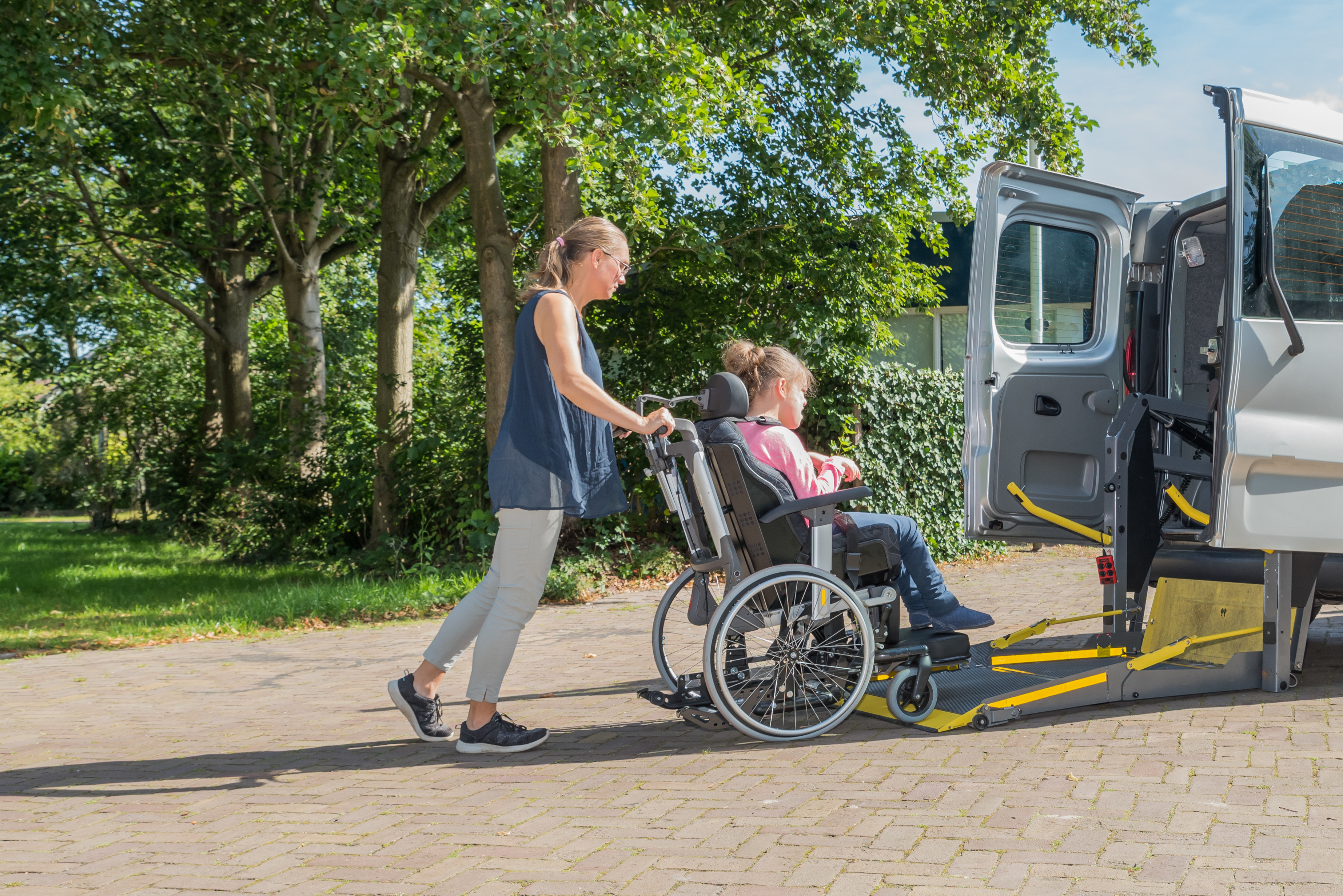 Vehicle adaption for wheelchair access